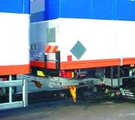 Retractable taik-lift for drawbar coupling vehicles